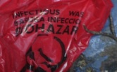 biohazard-infection-waste-bag-placed-in-yard-picked-up-and-put-in-trash-barrel-before-read-label