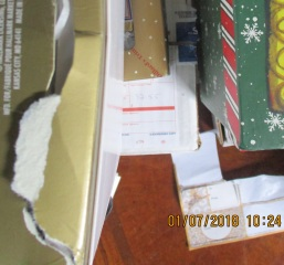 TSA cut into collector box for Polish Christmas ornament instead of opening 'open' box