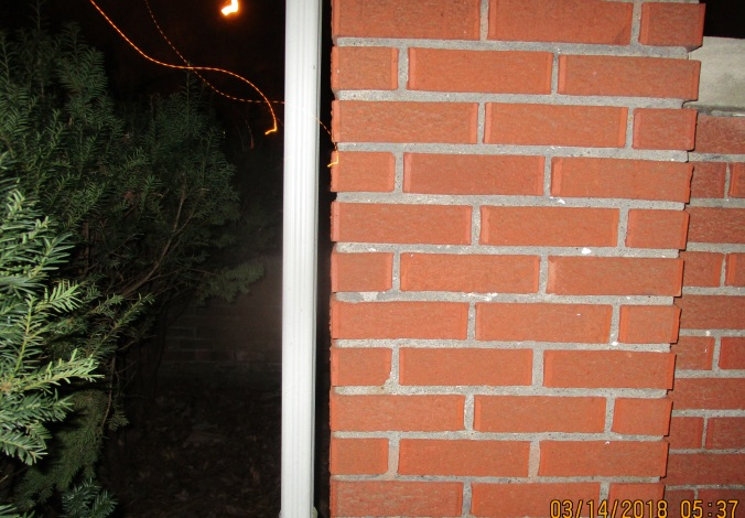 light reflecting off invisibility suit moving off porch