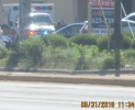 on way to library ambulance waiting in parking lot flashing lights 5-31-2018