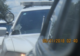 as seen through side mirror tailed upon entering Benton, Arkansas foot from bumper for miles
