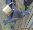 back gate on driveway seperating vacant rental from my home has lock once again broken open house used to target from