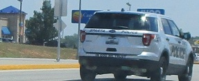 Sparta police car tailgated since Sunshine on Glenstone in slow lane till I was able to pull over 7-24-18