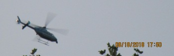 Long nosed Army helicopter circling home.jpg