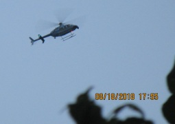 people hanging out lookind down as Army chopper flys over home.jpg