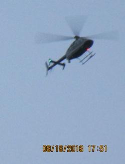 Short Army chopper flaps down circling house.jpg