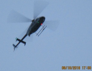 short Army helicopter flaps down cirling house in tandum with long, nosed Army helicopter with flaps up.jpg