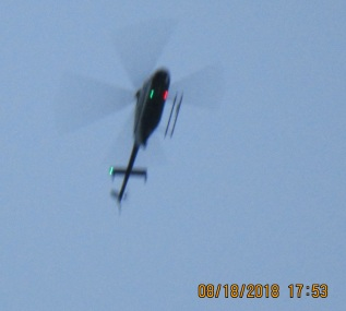short Army helicopter low to ground circling home