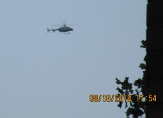 short , flaps down Army chopper with 'nose' pushed out in front circling home.jpg