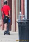wonderful Dad traveling with son on motorized skateboard
