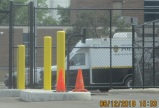 5 foot tall chain link constructed in last two months surrounds police parking and buildings