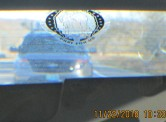 rearview mirror of tailgating cop
