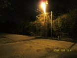 city curb in road visible at night drains into friends yard.jpg