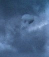 closeup of round object in cloud with shadow underneath